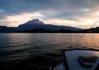The last rays of sunlight strike Mount Pilatus, as seen from Lake Lucerne.